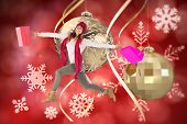 Smiling brunette jumping with gifts bags against hanging christmas decorations