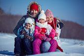 Happy family of four in winterwear