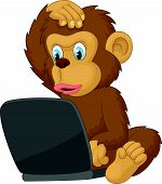 Cartoon monkey operating laptop