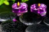 Spa Concept Of Zen Basalt Stones With Bead, Drops, Lilac Candles And Green Bamboo, Closeup