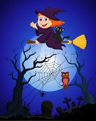 The witch flying on a broom on a full moon over the cemetery
