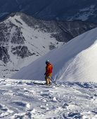 Skier On Off-piste Slope In Sun Evening