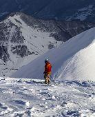 Skier On Off-piste Slope In Sun Evening