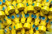 Many Yellow Gas Masks With Blue Glass