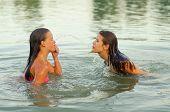 Teenage Girls Having Fun In The Sea