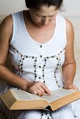 Woman hands holding Holy Bible