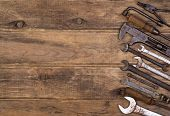 Old tools on wooden background with copy space
