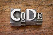 code word in mixed vintage metal type printing blocks over grunge wood
