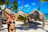 pic of caribbean  - Loving couple relaxing on sandy beach - JPG