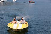 Two Men In A Speedboat