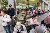 TAIPEI, TAIWAN - November 16th : Many tourists sitting in the corridor at Longshan Temple Park, Taipei, Taiwan on November 16th, 2014.