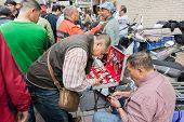TAIPEI, TAIWAN - November 16th : Street vendor selling various watches near Longshan Temple, Taipei, Taiwan on November 16th, 2014.