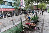 TAIPEI, TAIWAN - November 16th : Tramp Shuidao  on sidewalk near Longshan Temple, Taipei, Taiwan on November 16th, 2014.