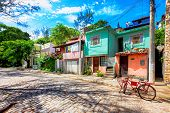 Colorful Small Houses Along A Cobbled Street In Buzios, Brazil