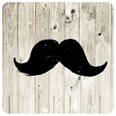 Moustache symbol on wooden texture. Raster version