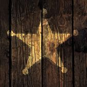 Grunge sheriff star on wooden texture. Raster version