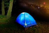 foto of nightie  - Tourist tent in nighty forest on sky background - JPG