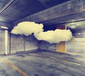 concrete structure series (parking garage with clouds inside) toned with a retro vintage instagram filter effect
