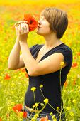 beautiful young woman with a bouquet of poppies