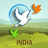 Flying pigeons in national flag colors with Ashoka Wheel on nature view background for Indian Republic Day and Independence Day celebrations.