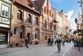 VILNIUS, LITHUANIA - SEPTEMBER 26: Tourists visit one of the most popular Pilies street of the old town on September 26, 2014 in Vilnius, Lithuania.
