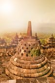 Beautiful ancient monument of Borobudur Buddhist temple at sunrise,  Yogyakarta, Java Indonesia.