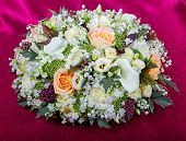 Wedding Bouquet From Lilies And Rose On A Red Fabric