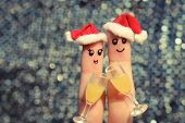 Finger art of a Happy couple. Couple making good cheer in the new year hats.
