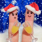 Finger art of a Happy couple. Couple making good cheer in the new year hats. Two glasses of champagn
