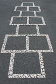 stock photo of hopscotch  - Hopscotch game painted on the parking lot.