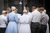 NEW YORK - SEPT 11, 2014: A group of men and women from the Pioneer Valley Mennonite Fellowship pray in front of the Millennium Hilton near the WTC site on the anniversary of the Sept 11th attacks.