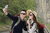 Asian couple travel and selfie in the outdoor.