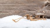 Old Rustic Wooden Sledge, Over Snow, Wooden Background