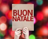 Merry Christmas (In Italian) card written on colorful background with defocused lights