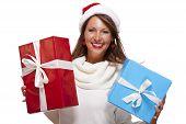 Vivacious Woman In A Santa Hat Celebrating Xmas
