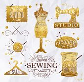 stock photo of coil  - Sewing symbol in retro vintage in gold color lettering mannequin - JPG