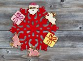 Holiday Cookie Decorations Around Red Snowflake