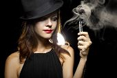 picture of e-cig  - woman smoking or vaping an electronic cigarette to quit tobacco - JPG