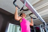 Pull ups Pull-up exercise workout girl at gym exercises