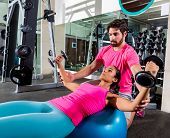 Dumbbell fit ball fly chest flies opening arms workout and personal trainer at gym