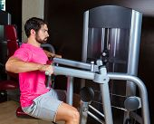Seated back row machine man workout exercise at gym
