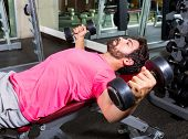 stock photo of open arms  - Dumbbell Incline Bench Flies opening arms workout exercise at gym - JPG