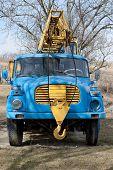image of crane hook  - Rusty old mobile crane with big hook - JPG