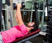 Dumbbell inclined bench Press flyes man exercise workout at gym