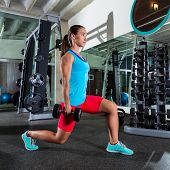 dumbbell lunge woman workout exercise at gym