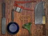 vintage kitchen utensils  over wooden wall, space for text and name