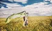 Healthy Pregnant Happy Woman Feeling Freedom Of Nature In Windy Gold Field