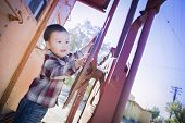 picture of railroad car  - Cute Young Mixed Race Boy Having Fun Outside on Railroad Car - JPG