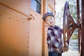 stock photo of railroad car  - Cute Young Mixed Race Boy Having Fun Outside on Railroad Car - JPG