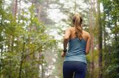 Healthy Lifestyle Fitness Sporty Woman Running Early In The Morning In Forest Area